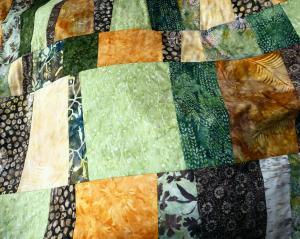 Quilt de patchwork de batiks para hombre.