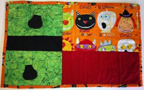 Halloween individual de patwchork, quilted tablemat